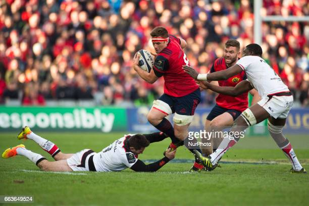 CJ Stander of Munster tackled by Yacouba Camara and Sebastien Bezy of Toulouse during the European Rugby Champions Cup QuarterFinal match between...