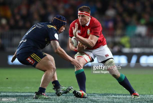 Stander of the Lions charges towards Daniel LienertBrown of the Highlanders during the 2017 British Irish Lions tour match between the Highlanders...