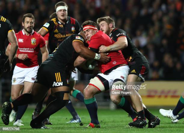 Stander of the Lions is tackled by Nepo Laulala and Liam Polwart of the Chiefs during the 2017 British Irish Lions tour match between the Chiefs and...