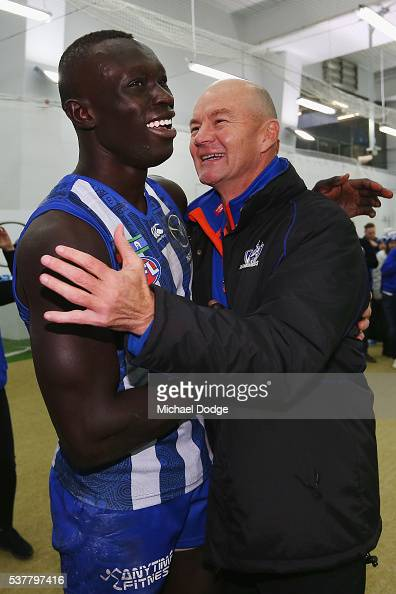 Standin coach Darren Crocker celebrates the win with Majak Daw during the round 11 AFL match between the North Melbourne Kangaroos and the Richmond...