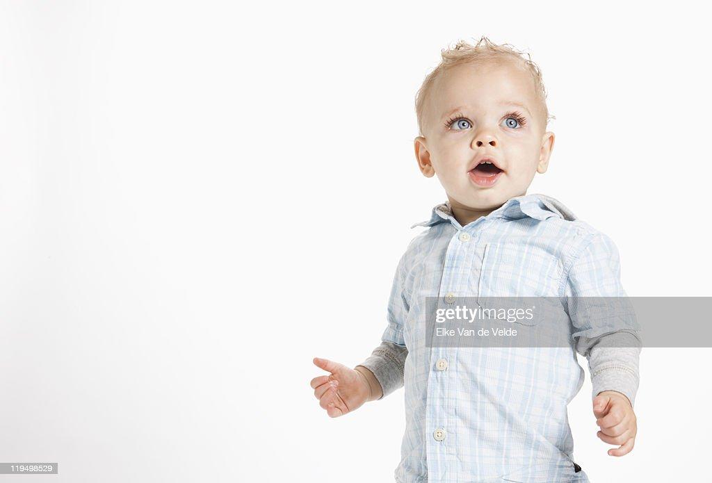 Standing baby boy : Stock Photo