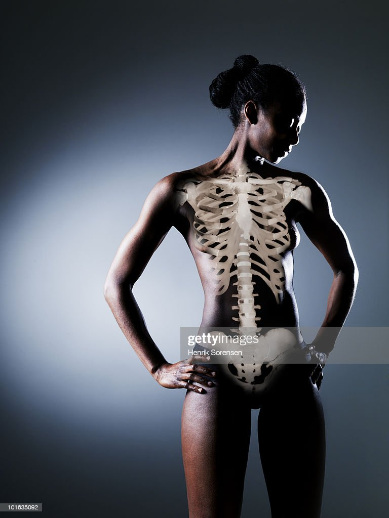 Standing female nude with skeleton visible : Stock Photo