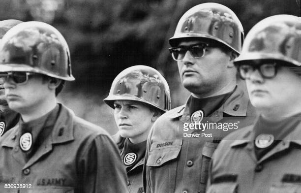 Standing in formation at rigid attention potential officers including Mrs Garrett at rear await inspection at the camp near Golden She's been a...