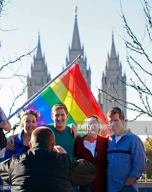 Standing in front of a pride flag with the historic Mormon Temple in the background people have their picture taken after they resign from the Church...