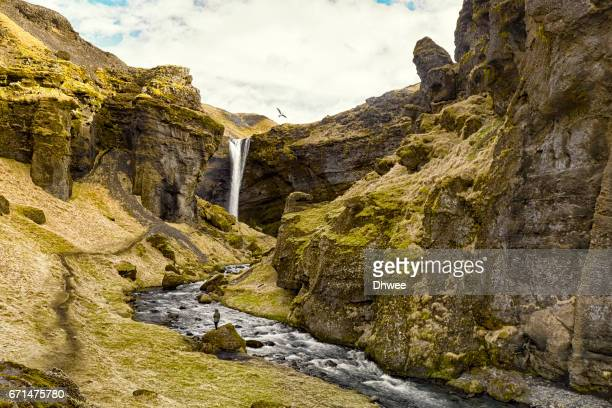 Standing In The Canyon Of Kvernufoss Waterfall, A Hidden Place In Iceland