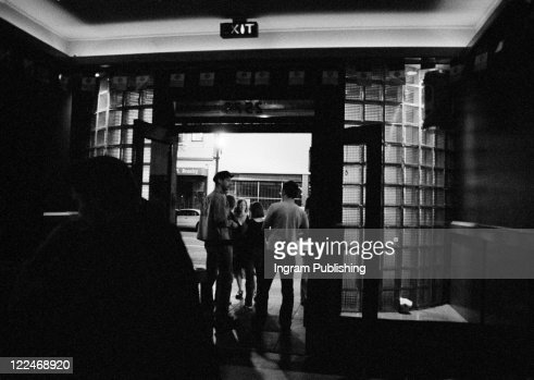 Standing In The Doorway Of A Neighborhood Bar : Stock Photo