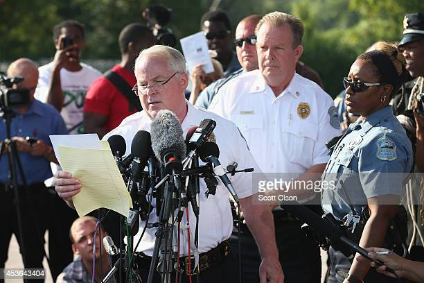 Standing in the parking lot of a gas station which was burned during rioting Ferguson Police Chief Thomas Jackson announces the name of the Ferguson...