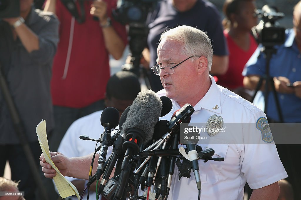 Standing in the parking lot of a gas station which was burned during rioting, Ferguson Police Chief Thomas Jackson announces the name of the Ferguson police officer responsible for the August 9, shooting death of teenager Michael Brown on August 15, 2014 in Ferguson, Missouri. The officer was identified as Darren Wilson, a six year veteran of the police department. Brown's killing sparked several days of violent protests in the city.