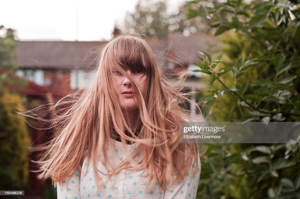 Standing in wind : Stock Photo