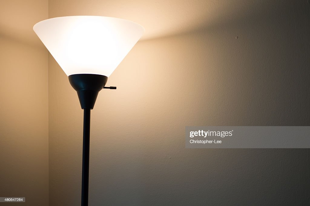 Standing lamp with light on : Stock Photo