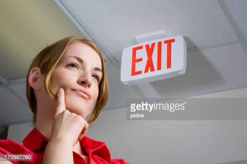 Standing near the exit