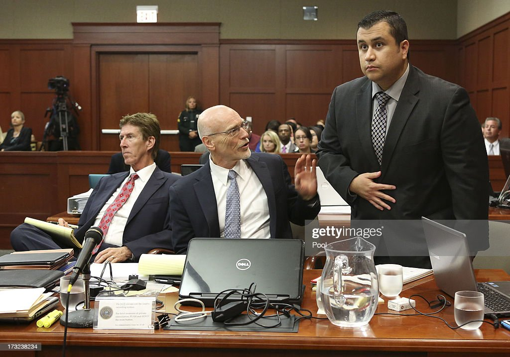 Standing next to his defense attorneys Mark O'Mara, (L), and Don West, (C), <a gi-track='captionPersonalityLinkClicked' href=/galleries/search?phrase=George+Zimmerman&family=editorial&specificpeople=9042868 ng-click='$event.stopPropagation()'>George Zimmerman</a> addresses Judge Debra Nelson during his trial in Seminole circuit court July 10, 2013 in Sanford, Florida. Zimmerman has been charged with second-degree murder for the 2012 shooting death of Trayvon Martin.