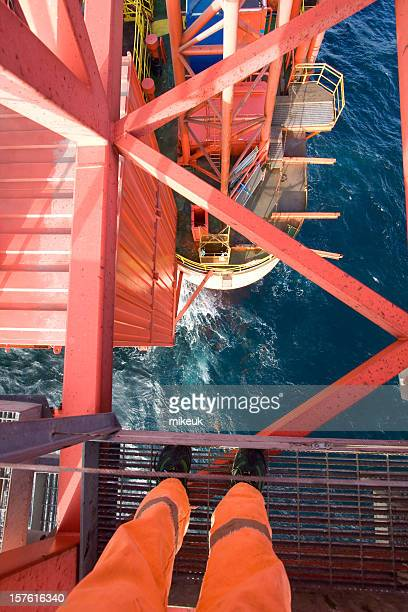 standing on a oil rig at sea