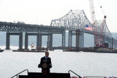 Standing on stage with a backdrop of the Tappan Zee bridge US President Barack Obama speaks on the need for a '21st Century Transportation...