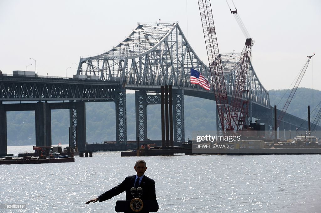 Standing on stage with a backdrop of the Tappan Zee bridge, US President Barack Obama speaks on the need for a '21st Century Transportation Infrastructure' in Tarrytown, New York, on May 14, 2014. AFP PHOTO/Jewel Samad