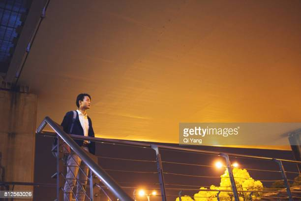 Standing on the bridge businessman