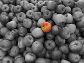 An apple in color stands out against the crowd