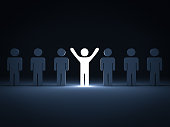 Stand out from the crowd and different concept , One light man standing with arms wide open with other people.