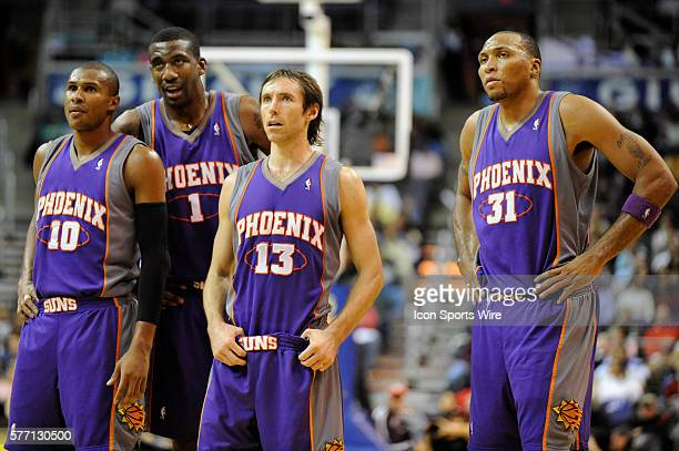 Standing Phoenix Suns guard Leandro Barbosa center Amare Stoudemire guard Steve Nash and forward Shawn Marion wait for a fouls shot to be completed...