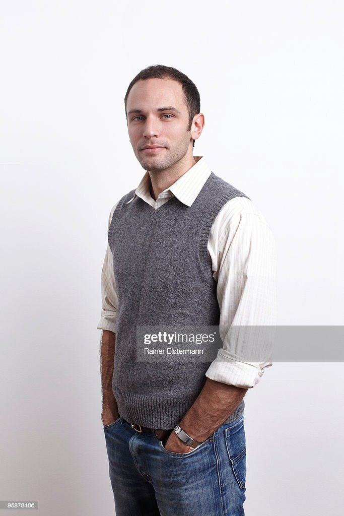 Standing portrait of young man, studio shot