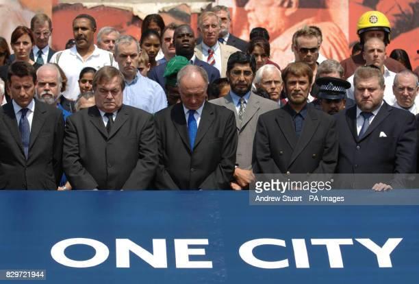 Standing silently Lord Sebastian Coe Deputy Prime MInister John Prescott Mayor of London Ken Livingstone Imam Iqbal Sidiqui and Rabbi Jonathan Sachs...
