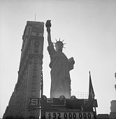 Standing tall over Times Square in New York City Liberty's sister a 15 ton replica of the Statue of Liberty which was erected towards the end of the...
