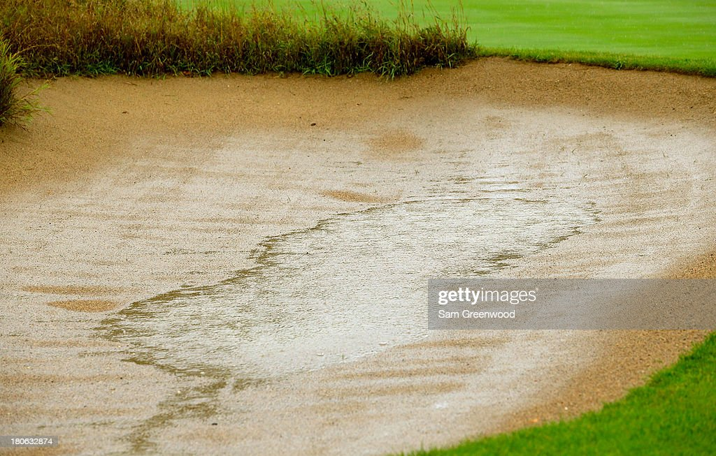 Standing water is seen in a bunker as play is suspended due to inclement weather during the Final Round of the BMW Championship at Conway Farms Golf Club on September 15, 2013 in Lake Forest, Illinois.