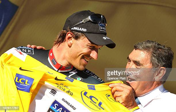Standing with champion cyclist Eddy Merckx who is celebrating his 65th birthday Swiss rider Fabian Cancellara of team Saxo Bank retained the race...