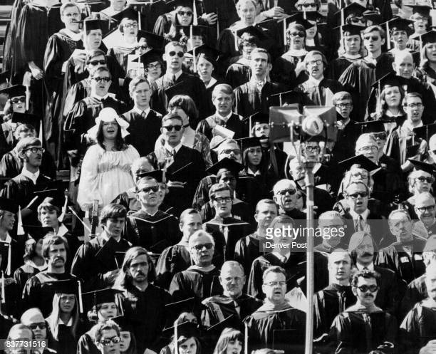 Standout In University of Colorado Graduation Exercises Penny Marse bachelor of fine arts graduate from San Carlos Calif stands out in her white...