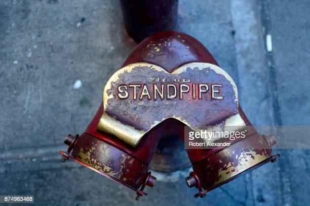A standpipe at the base of a multistory building in New York New York Standpipes are used by firefighters to get water to the upper floors of tall...