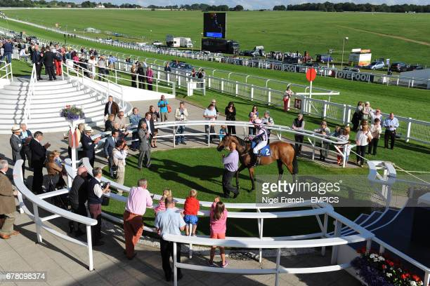 Standpoint ridden by David Kenny in the winners enclosure at Epsom Downs Racecourse following their victory in the Download Epsom's Android Or Iphone...