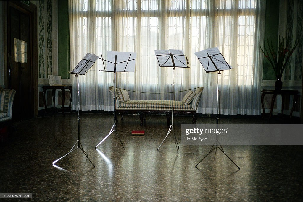 Stands displaying sheet music arranged in room : Stock-Foto