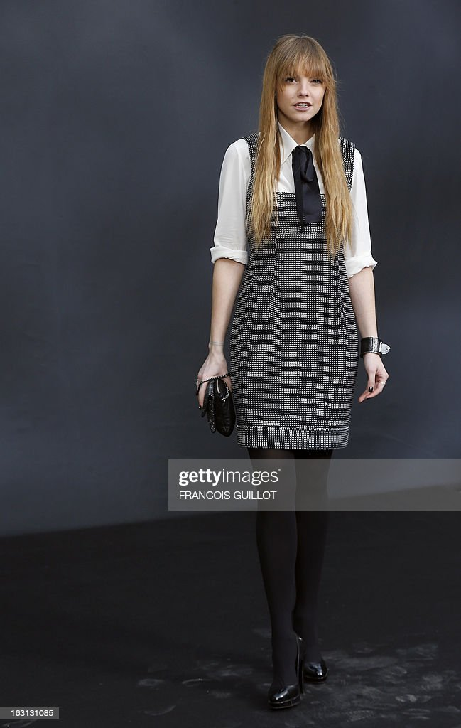 US stand-up comedian Laura Hayden poses on March 5, 2013 as she arrives to attend Chanel's Fall/Winter 2013-2014 ready-to-wear collection show at the Grand Palais in Paris. AFP PHOTO/FRANCOIS GUILLOT