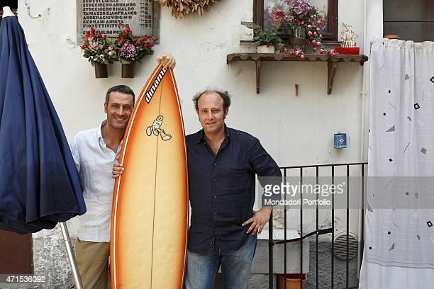 'Standup comedians Ale e Franz Alessandro Besentini and Francesco Villa respectively pose smiling in the courtyard in Naviglio Martesana via Monza...