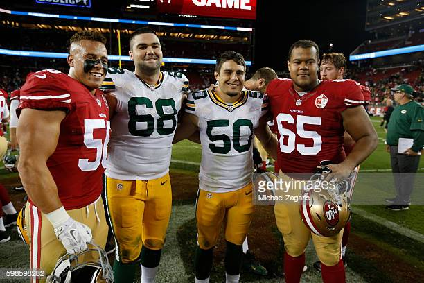 Stanford alumni Shayne Skov and Joshua Garnett of the San Francisco 49ers and Kyle Murphy and Blake Martinez of the Green Bay Packers stand on the...