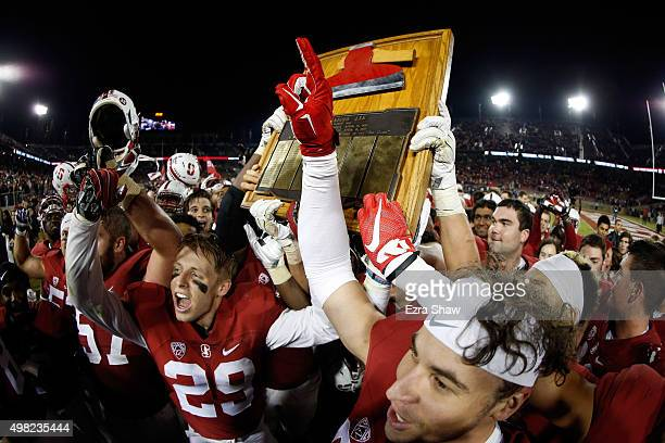 Stanford Cardinal celebrate with 'The Axe' after they beat the California Golden Bears 3522 in the Big Game at Stanford Stadium on November 21 2015...
