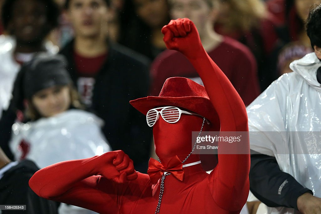 A Stanford Cardinal fan cheers on his team during the Pac-12 Championship game at Stanford Stadium on November 30, 2012 in Stanford, California.