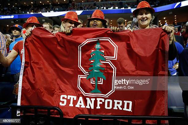 Stanford Cardinal fans pose for a photo during a regional semifinal of the 2014 NCAA Men's Basketball Tournament against the Dayton Flyers at the...