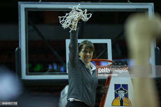 Stanford Cardinal head coach Tara VanDerveer cuts down the net after the women's Pac 12 college tournament championship game between the Oregon State...