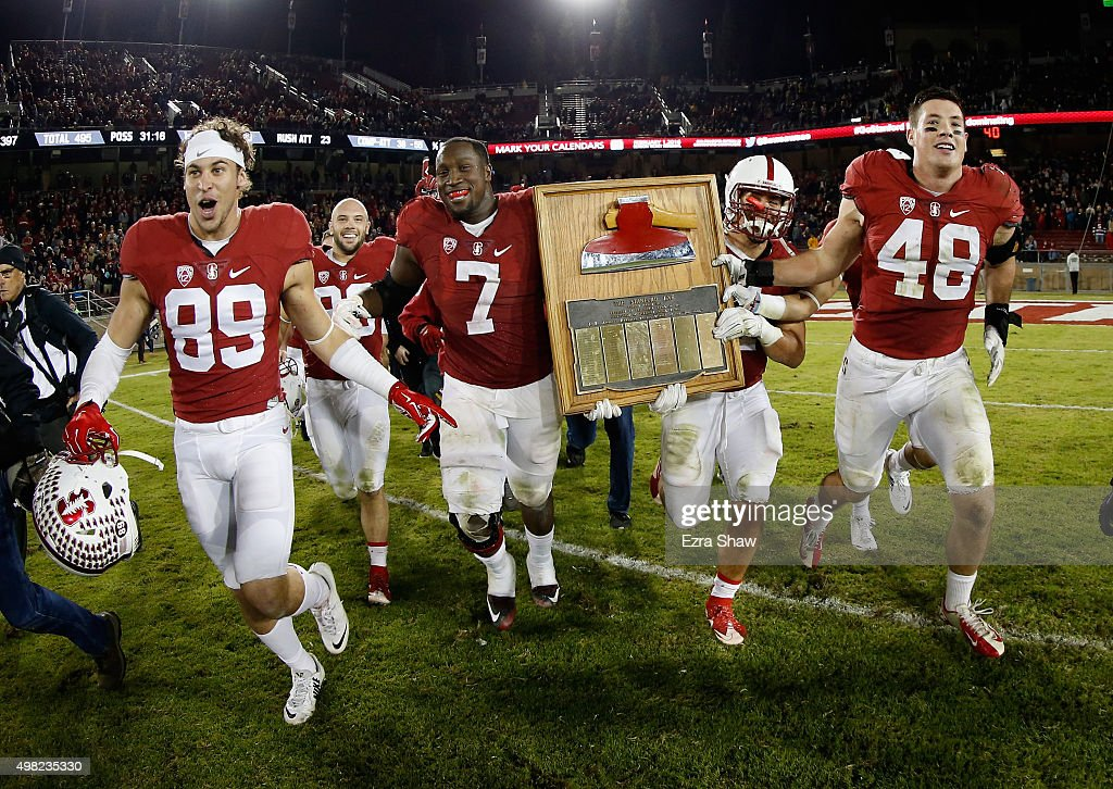 Stanford Cardinal players run across the field with 'The Axe' after they beat the California Golden Bears 3522 in the Big Game at Stanford Stadium on...