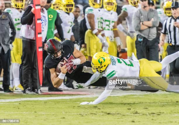 Stanford Cardinal wide receiver JJ ArcegaWhiteside comes down with a sideline pass ahead of Oregon Ducks safety Tyree Robinson during the regular...