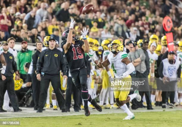 Stanford Cardinal wide receiver JJ ArcegaWhiteside reaches out for a sideline pass with Oregon Ducks cornerback Thomas Graham Jr in pursuit during...