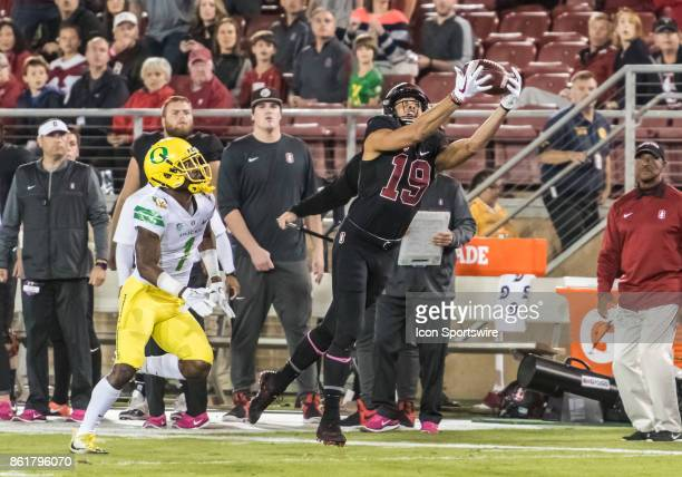Stanford Cardinal wide receiver JJ ArcegaWhiteside reaches out to complete a pass catch with Oregon Ducks cornerback Arrion Springs looking on during...