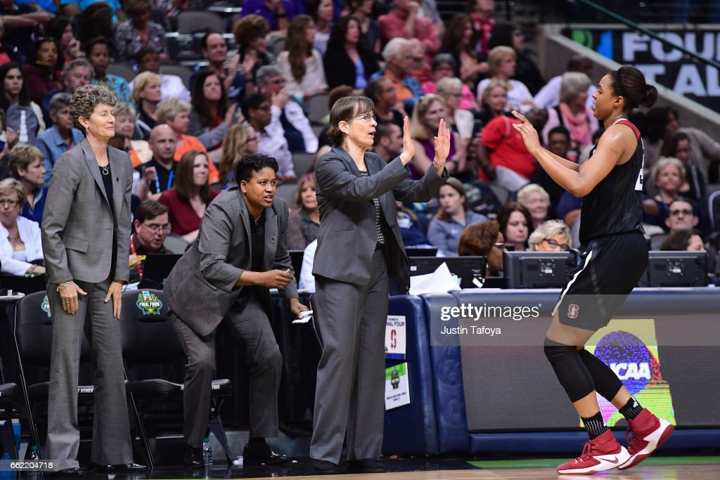 Stanford head coach Tara VanDerveer high fives Erica McCall #24 of the Stanford Cardinal during the 2017 Women's Final Four at American Airlines Center on March 31, 2017 in Dallas, Texas.