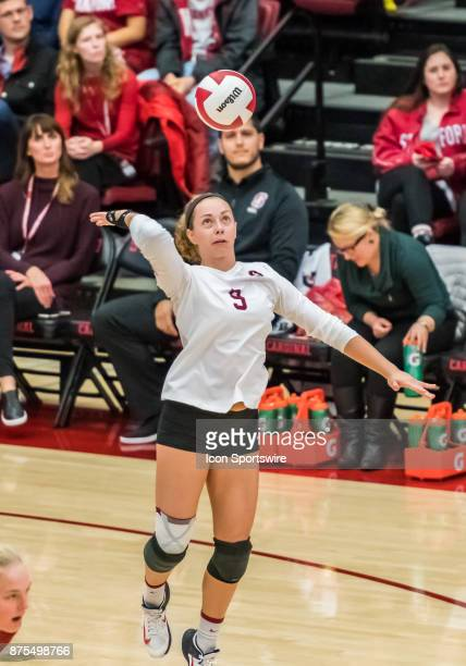 Stanford libero Morgan Hentz delivers a serve during the regular match between the UCLA Bruins and the Stanford Cardinals on Thursday November 16...