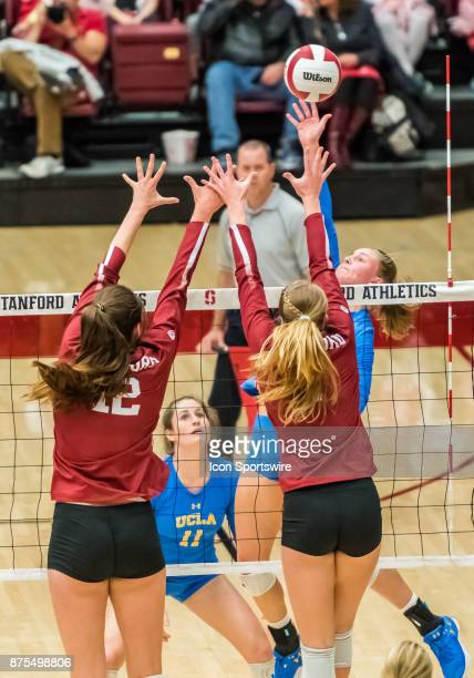 Stanford middle blocker Audriana Fitzmorris and Stanford setter Jenna Gray set up a block against UCLA outside hitter Reily Buechler during the...