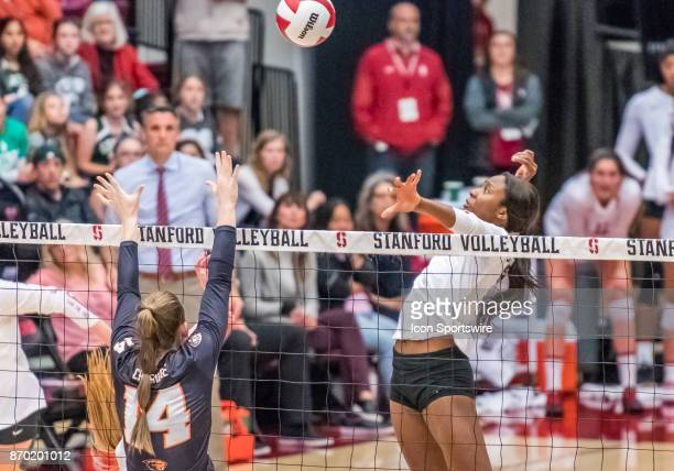 Stanford middle blocker Tami Alade focuses on a hit for the score during the regular season game between the Oregon State Beavers verses the Stanford...