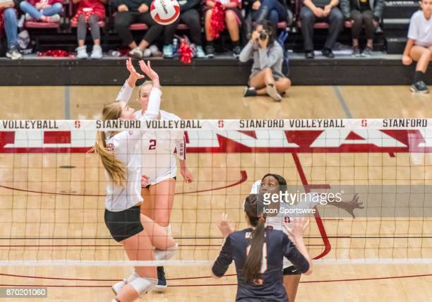 Stanford middle blocker Tami Alade gets ready to intercept the set by Stanford setter Jenna Gray during the regular season game between the Oregon...