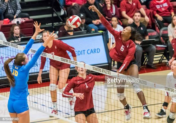 Stanford middle blocker Tami Alade goes up high for a slam during the regular match between the UCLA Bruins and the Stanford Cardinals on Thursday...