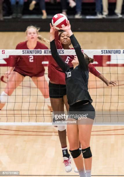 Stanford middle blocker Tami Alade reaches over the net to dislodge a set attempt by Oregon defensive specialist Kyra Hanawahine during the regular...